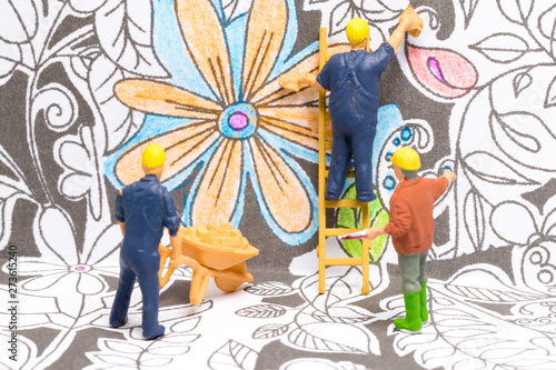 Poster Pays d Asie Macro shot on miniature figures as painters working on colouring details on a wallpaper