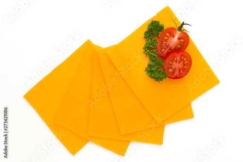 Fototapeta Cheddar cheese slice isolated on the white background. obraz