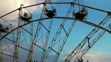 Old Ferris Wheel In The Park Near The Forest And River. Part 4