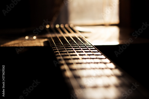 Acoustic Guitar In Music Studio Close up. Shined By The Sun At The Golden Hour - 273629262