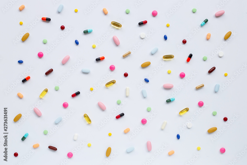 Fototapety, obrazy: Colorful tablets with capsules and pills on white.