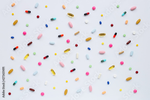 Colorful tablets with capsules and pills on white. Fototapeta