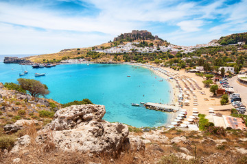 Idyllic Paradise landscape of the resort town of Lindos on the island of Rhodes, Greece. The concept of holidays in the tropics and historical cities