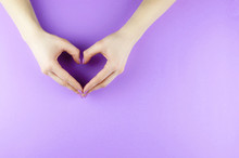 Female Hands With A Purple Manicure In The Form Of A Heart.