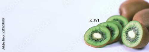 Fotografia A kiwi fruit is sliced on a white background