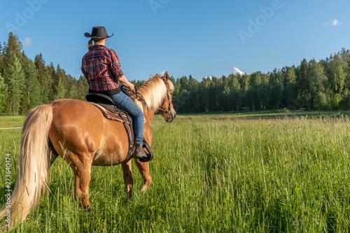 Fototapeta Woman horseback riding obraz