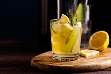 Fresh Organic Summer Cocktail Made With Sour Ginger Craft Beer Or Kombucha Tea With Cucumber And Lemon On Wooden Background.Drink On The Bar Table With Copy Space.Trendy Vegan Refreshing Beverage