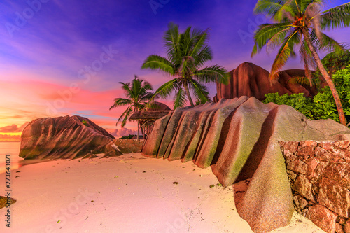 Fototapeta  Dramatic colorful sky dusk at scenic Anse Source d'Argent in Seychelles, La Digue