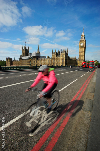 Fast moving London bicycle commuter crossing Westminster Bridge. #273645266