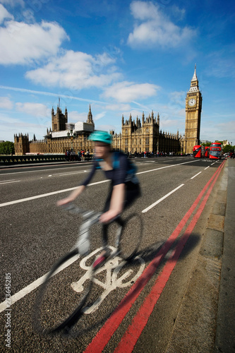 Fast moving London bicycle commuter crossing Westminster Bridge. #273645285