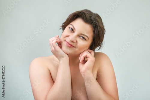 Portrait of beautiful plus size woman on light background Tablou Canvas