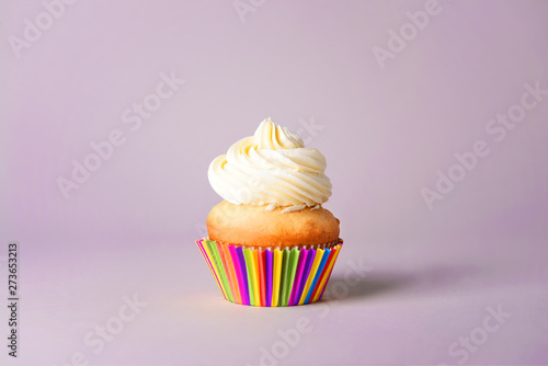 Tasty Birthday cupcake on grey background Wallpaper Mural