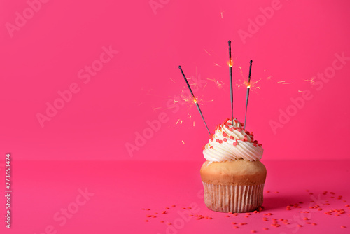 Tasty Birthday cupcake on color background Wallpaper Mural