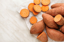 Raw Sweet Potato On Light Back...