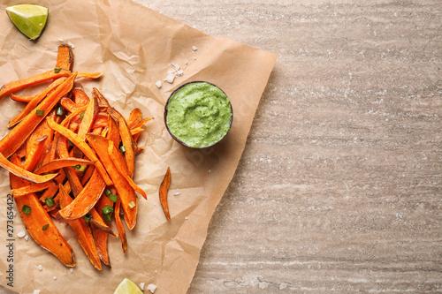 Obraz na płótnie Tasty cooked sweet potato and sauce on table