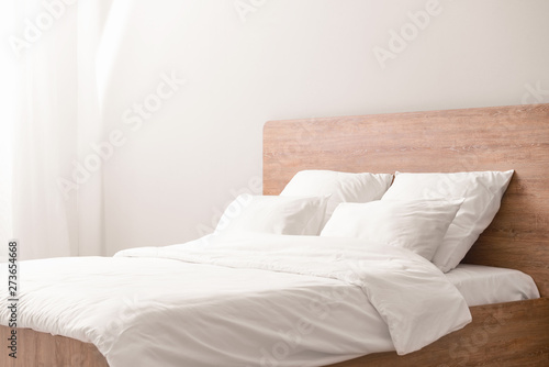 Cozy bed with soft pillows Fototapeta
