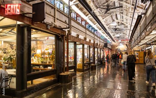 Fototapeta USA, New York, Chelsea market. People walking in the hall obraz