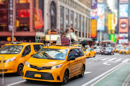 Foto op Aluminium New York TAXI New York, Broadway streets. High buildings, colorful neon lights, ads and cars