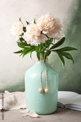 Vase with beautiful peony flowers on table Canvas Print
