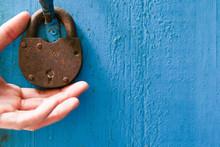 Old Lock On The Blue Door. Lock On The Door Of An Old Farmhouse. True Village Style. Man Holds Lock