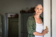 Mature Woman Standing At Door