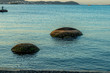 Isolated two stone. Two round stones in the sea.