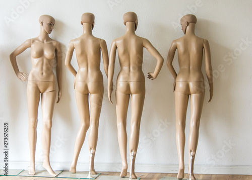 group of undressed mannequins in a shop in Berlin Canvas Print