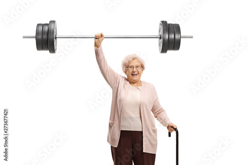 Obraz Senior woman with a cane liftiing a barbell - fototapety do salonu