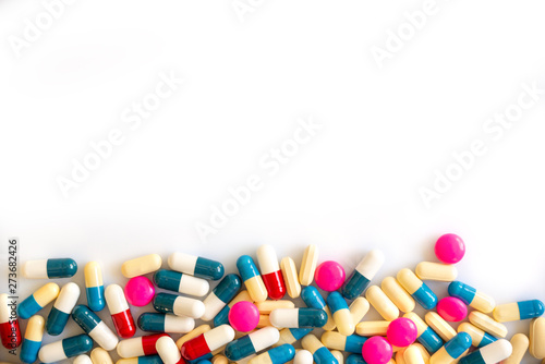 Fotografia  Colorful pills and medication on white background with copy space, health and me
