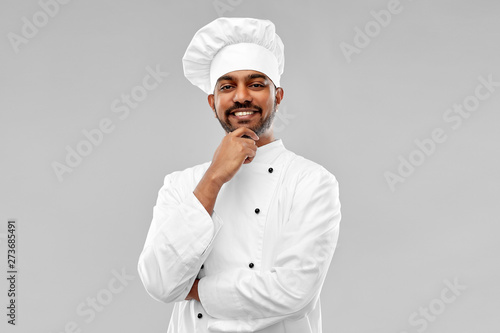 Poster Ecole de Danse cooking, profession and people concept - happy male indian chef in toque over grey background