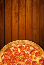 Pizza On Wooden Background. Top View Of Hot Pizza Pepperoni Closeup With Mozzarella Cheese. Banner Flat Lay With Copy Space
