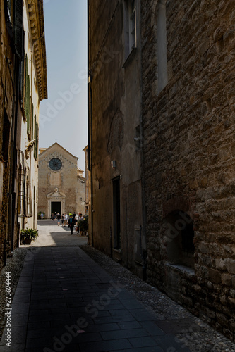 Alley with view of the Albenga cathedral Wallpaper Mural