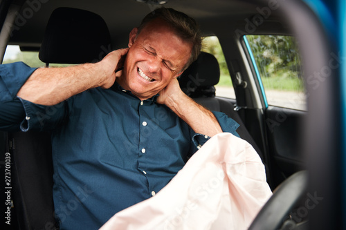 Male Motorist With Whiplash Injury In Car Crash With Airbag Deployed Canvas Print