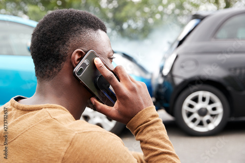 Male Motorist Involved In Car Accident Calling Insurance Company Or Recovery Ser Fototapeta