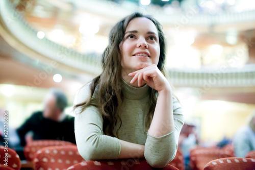 Fotografie, Tablou  Portrait of smiling woman sitting in theatre salon