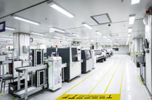 """On A Floor Of The Electronics Manufacturing Covered Industrial Linoleum Pastes A Yellow Tape With A Standard Warning Text: """"ESD Protected Area"""",Blurred Background,copy Space For Texture"""