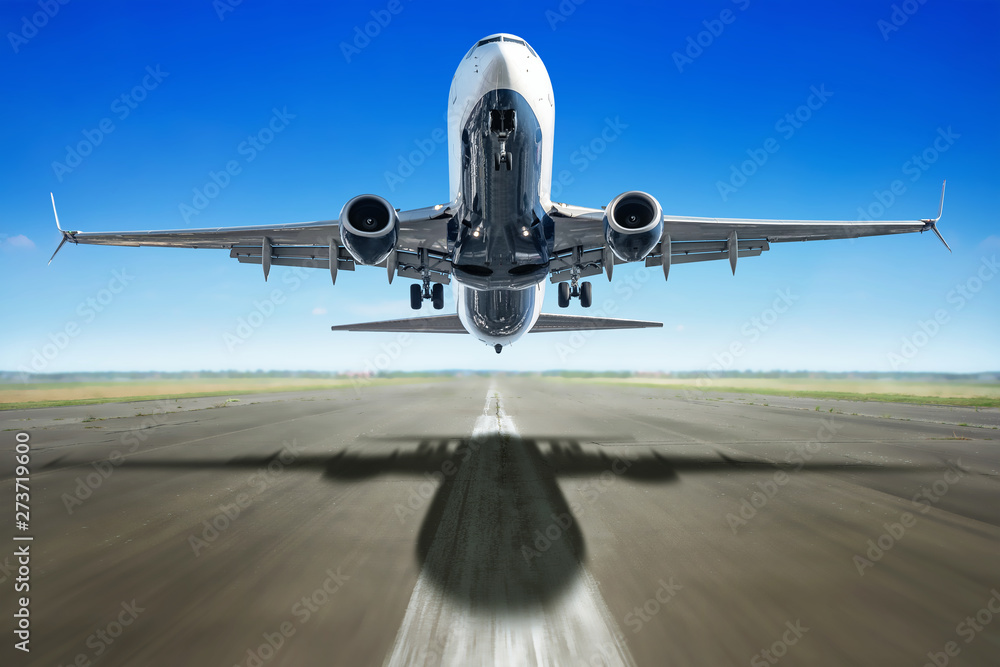 Fototapety, obrazy: take off of an modern airliner against a blue sky