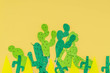 paper cactuses on yellow background