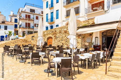 Restaurant tables in port Bo of Calella de Palafrugell, Costa Brava, Catalonia, Poster Mural XXL