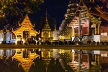 View Of Wat Phra Singh Temple Reflecting In Water