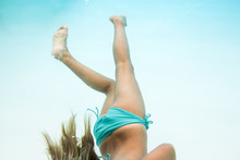 Girl In Bikini Swimming Underwater