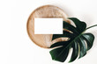 canvas print picture Tropical summer stationery mock-up scene. Blank business card, wooden tray, green monstera leaf isolated on white table background. Summer branding styled photo, web banner. Flat lay, top view