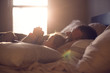 Parent and child share a lazy morning in beautiful, dreamy light.