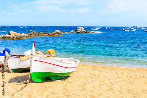 Traditional fishing boat on beach in Calella de Palafrugell, scenic village with Fototapet