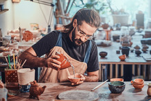 Diligent Man Is Putting Colourful Clay To His New Handmade Pot.