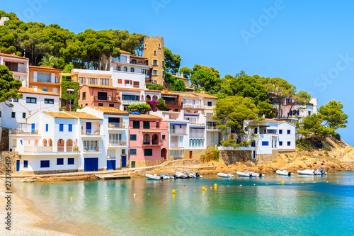 View of colorful houses in sea bay with beach in Sa Tuna coastal village, Costa Brava, Spain