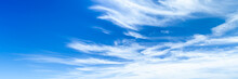 Banner Of Cirrus Clouds With Deep Blue Sky Background