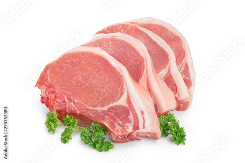 Fotografía  sliced raw pork meat with parsley isolated on white background
