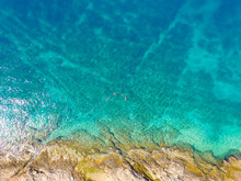 Aerial View Of Tourists Swimmi...