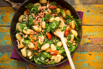 Gnocchi with bacon, spinach & tomatoes